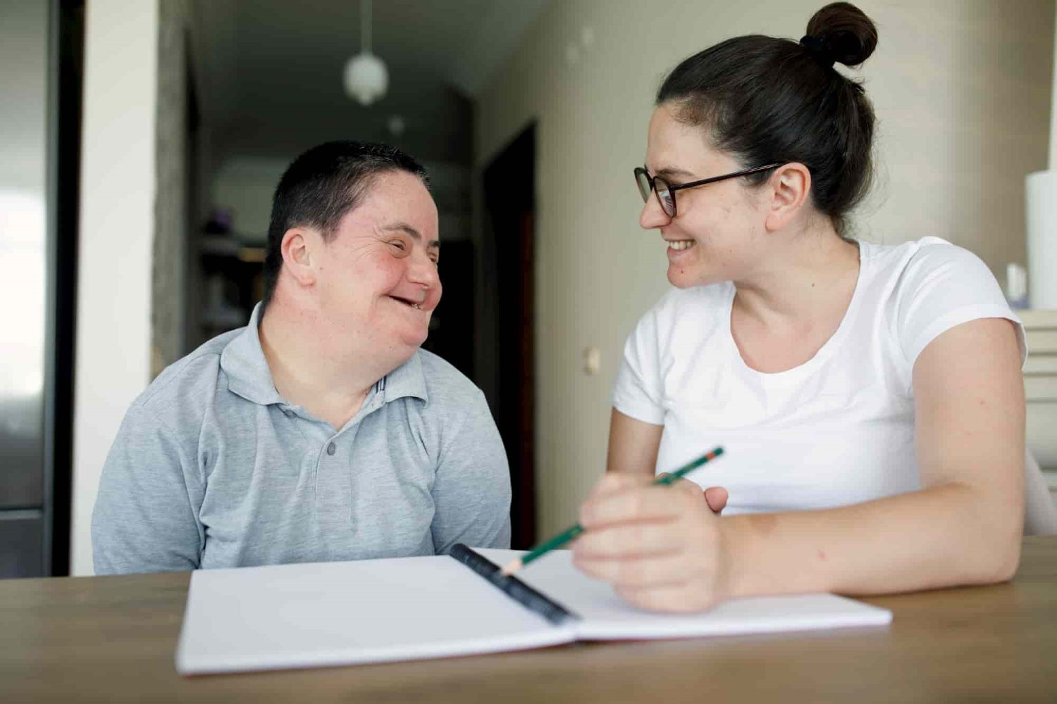 A person with a disability and a lady having a discussion